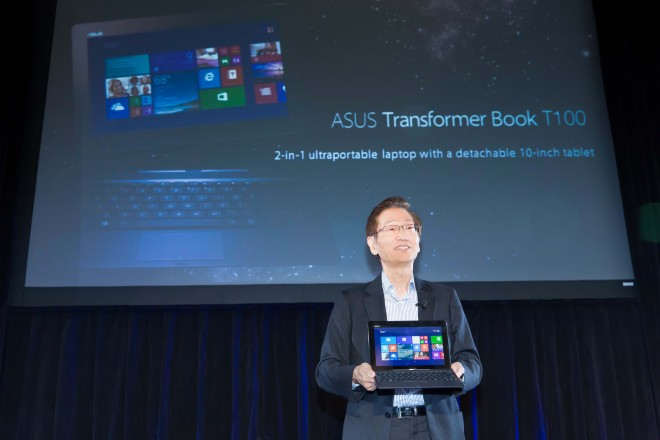 Asus Chairman Jonney Shih holds the Transformer Book T100
